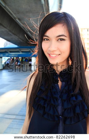 Young pretty asian woman smiling