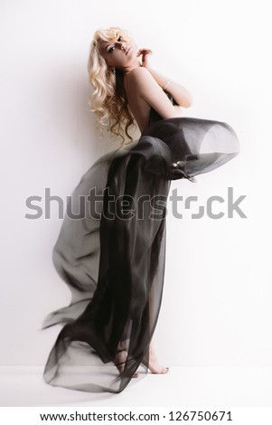 Young pretty blond on white with transparent cloth in full length