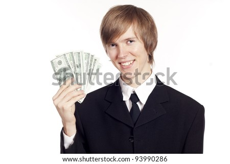 Young pretty businessman holding cash