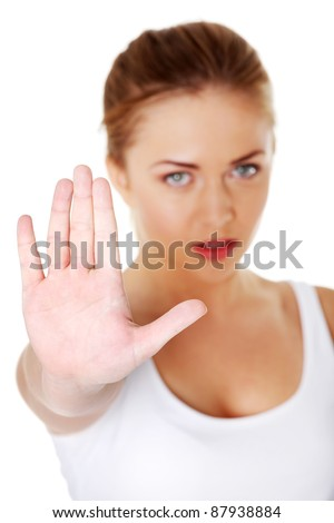 Young pretty caucasian girl showing stop gesture over white background. - stock photo