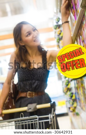 young pretty caucasian lady shopping for offers and bargains