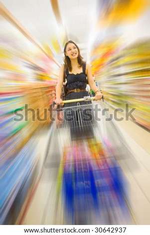 young pretty caucasian lady shopping indoor with zoom motion blur