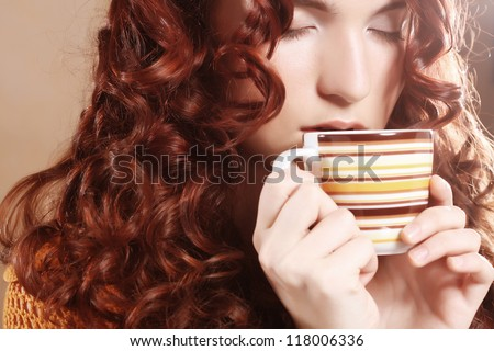 young pretty curly woman drinking coffee