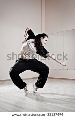 young pretty dancer in motion. photo in dance studio