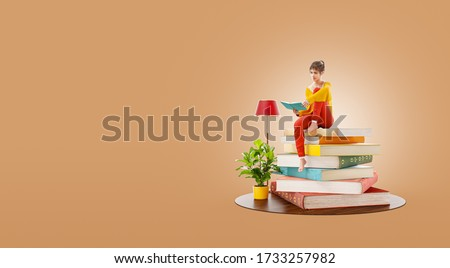 Young pretty female reads sitting on a stack of books. Reading and education concept. Unusual 3d illustration