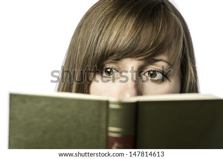 Young pretty female student reads a book to learn, isolated on white background