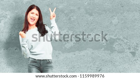 young pretty girl full body with a proud, happy and confident expression; smiling and showing off success while gesturing victory, giving an