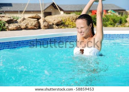 Young pretty girl having fun in swimming pool #58859453