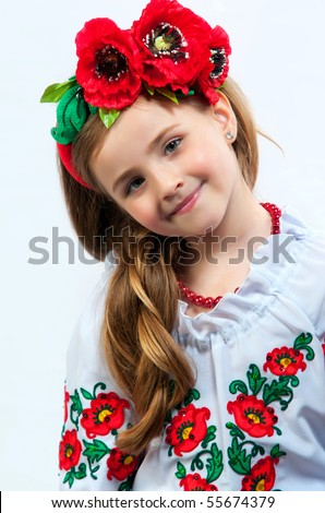 Young pretty girl in a ukrainian national costume on a light background