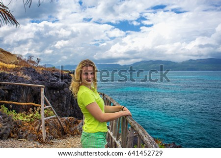 Young pretty girl on background of the sea from the high cliff. Samana, Dominican Republic #641452729