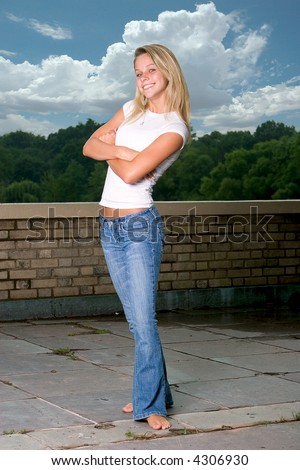 Young pretty girl posing barefoot