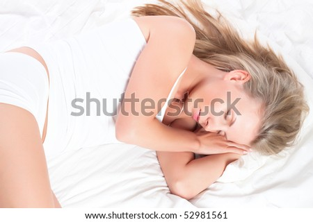 Young pretty girl sleeping in bed. Sweet dreams