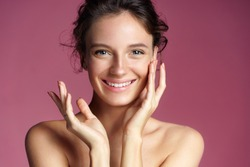 Young pretty girl with natural makeup on pink background. Beauty & Skin care concept