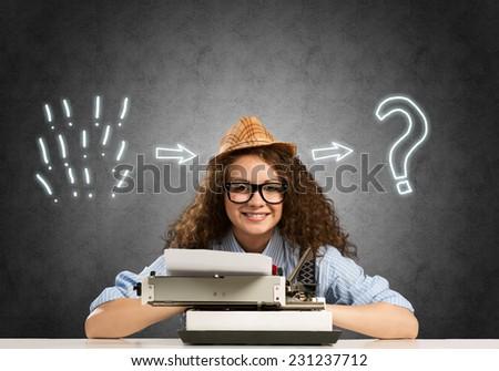 Young pretty girl writer using typing machine