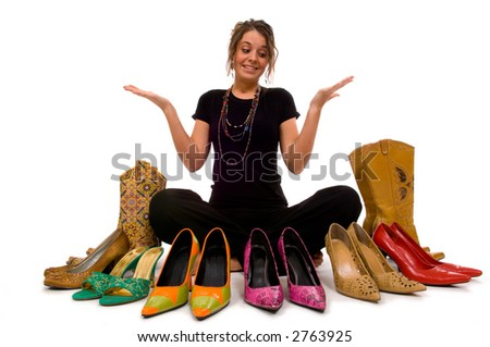 Young pretty lady tries to decide what shoes to wear, decisions