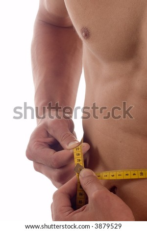 Young pretty man measuring his perfect body isolated on white