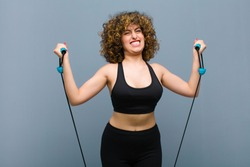 young pretty sports woman wearing fitness clothes and doing exercise
