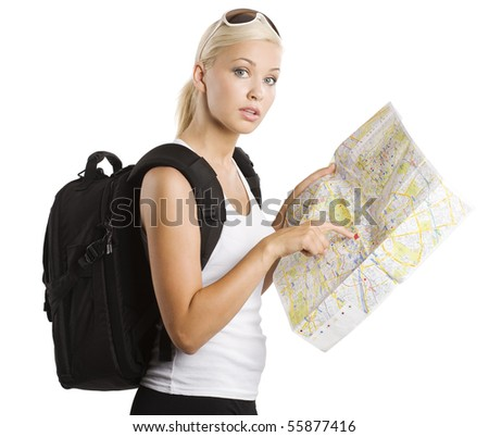 young pretty student girl in vacation looking for place on a map with rucksack