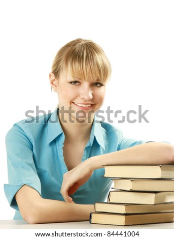 Young pretty student lying on a stack of book