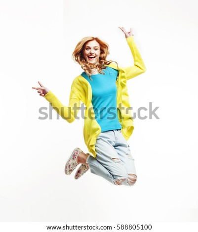 young pretty teenage girl jumping cheerful isolated on white background, lifestyle people concept #588805100