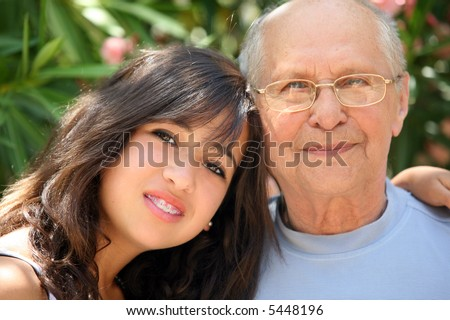 Young pretty woman and her grandfather