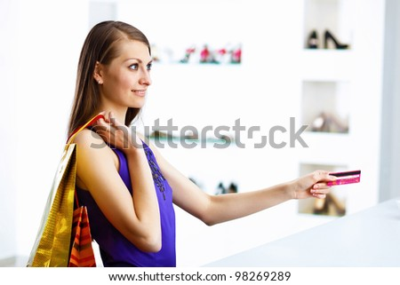 Young pretty woman doing shopping with credit card