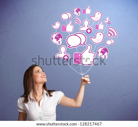 Young pretty woman holding social icon balloon