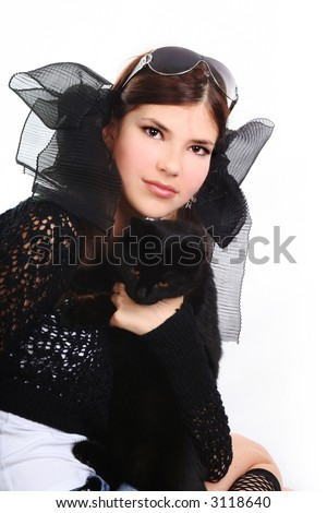 young pretty woman in black with pussy cat on the white background