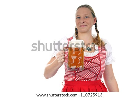 young pretty woman in dirndl with beer mug / munich beer festival