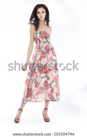 Young pretty woman in elegant light fashion dress, studio shot, series of photos