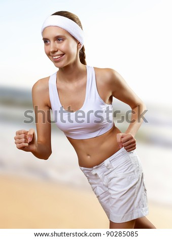 Young pretty woman in sport wear doing sport