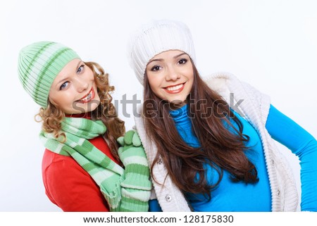 Young pretty woman in warm winter hat and scarf