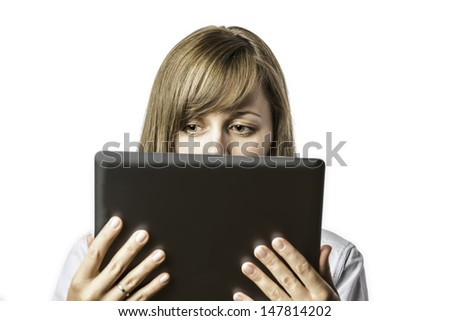Young pretty woman looks on her tablet computer, isolated on white background