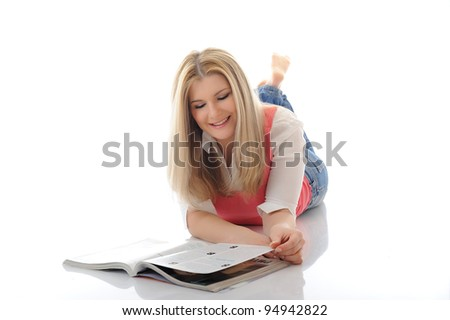 young pretty woman reading magazine. isolated on white