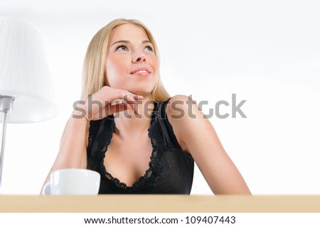 Young pretty woman sitting at her desk dreaming and planning while resting - stock photo