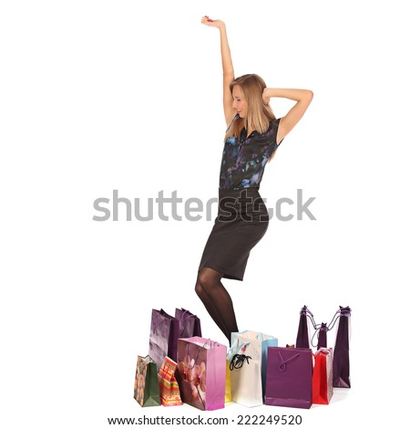 young pretty woman standing with colorfool shopping bags, studio #222249520