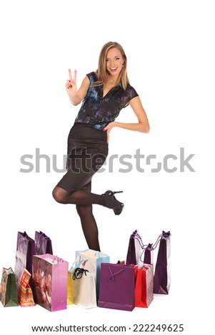 young pretty woman standing with colorfool shopping bags, studio #222249625