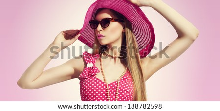 young pretty woman summer portrait in pink dress, sunglasses high heels and hat