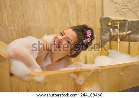 Young Pretty Woman Taking A Bubble Bath 244188460