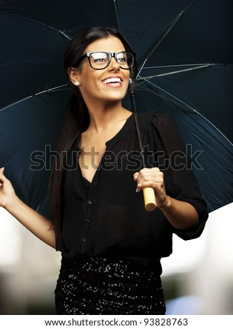 young pretty woman with an umbrella against an abstract background