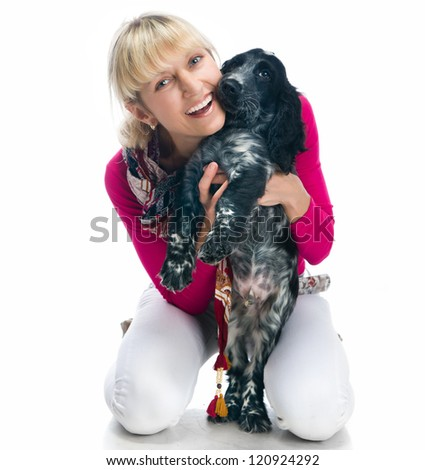 young pretty woman with her puppy over white background