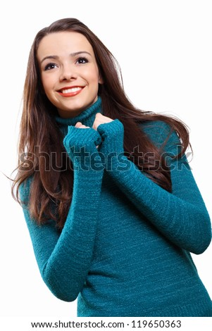 Young pretty woman with long hair wearing warm pullover