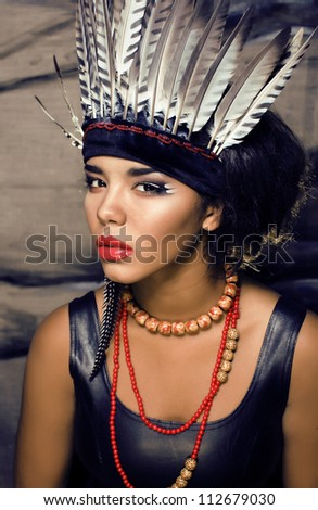 young pretty woman with make up like red indian