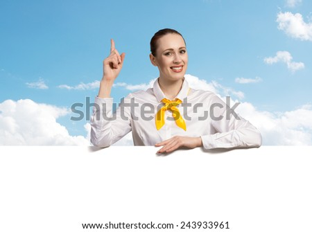Young pretty woman with white blank banner
