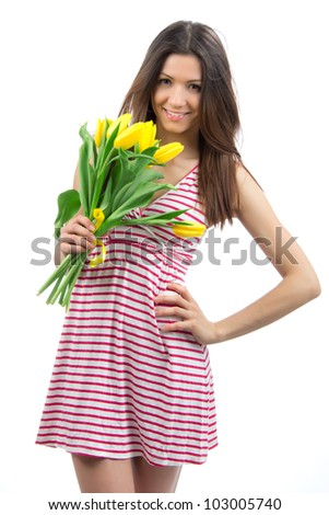 Young pretty woman with yellow tulips bouquet of flowers smiling on white background