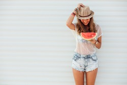 young pretty women holding a slice of watermelon in hands and smiling happy, summertime concept and mood, over an white background with lines