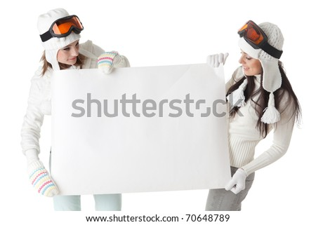 Young pretty women in ski glasses and winter clothes with empty board for the text on a white background.