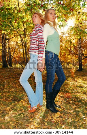 Young pretty womens in the autumn park. - stock photo