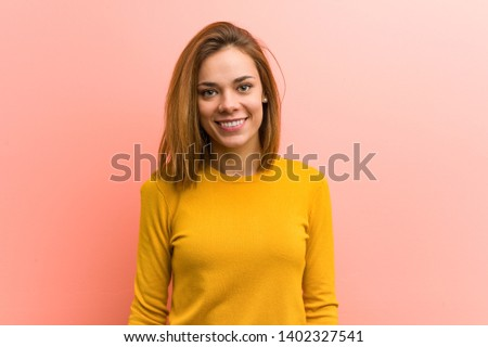 Young pretty young woman happy, smiling and cheerful.