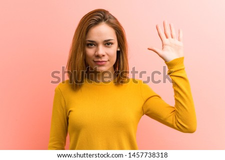 Young pretty young woman smiling cheerful showing number five with fingers.